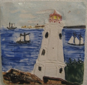 5.5 Louisbourgh Lighthouse tile, with foundation of oldest lighthouse in Canada in foreground. Tall ships and the fortress in the background, Has notch to use as a wall hanging.